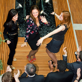 Ladies dances while corporate event djs spins the tunes